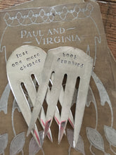 Display of two upcycled serving fork bookmarks handstamped with phrases about books