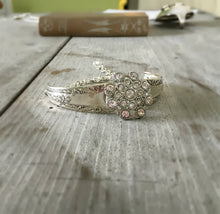 Front view of Bracelet made from two Camelia spoon handles and a flower shaped rhinestone button