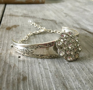 Bracelet made from two Camelia spoon handles and a flower shaped rhinestone button