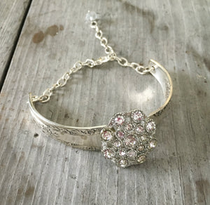 Camelia spoon handle link bracelet and a flower shaped rhinestone button and crystal bead