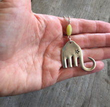Handmade Fork Elephant Necklace Shown in hand for scale