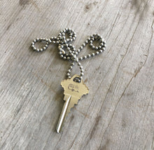 Hand stamped giving key necklace with airstream camper