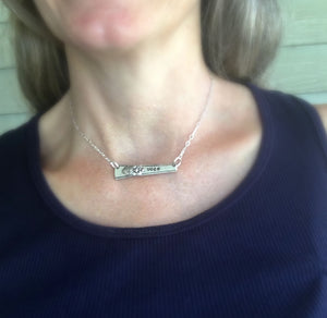 Upcycled silverware bar Necklace Hand Stamped Vote shown on model