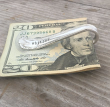 Side view of spoon money clip hand stamped WHISKEY