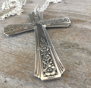 Detailed view of Cross necklace made from upcycled vintage silverplate spoon handles