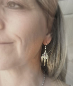 Upcycled cocktail fork earrings shown on model