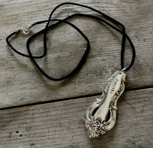 Serving spoon handle necklace stamped BLESSED hangs from long black leather cord