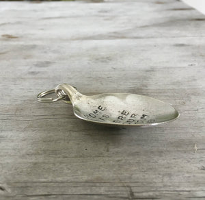 Side View of Spoon keychain hand stamped with HOME IS WHERE your mom is