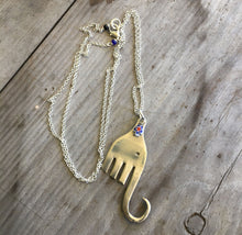 UPcycled silverware necklace in shape of an elephant with millefioiri bead