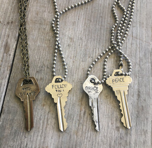 Four hand stamped giving key necklaces