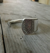 Spoon handle jewelry featuring Victorian design