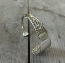 Cutlery bracelet from upcycled silverplate spoon with Victorian design shown standing upright