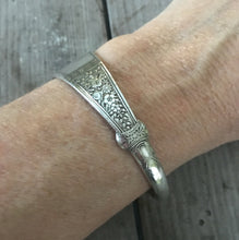 Cuff Bracelet made from upcycled spoon shown on model's wrist