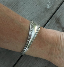 1847 Rogers Avon Spoon made into a cuff bracelet shown on model's arm from the top