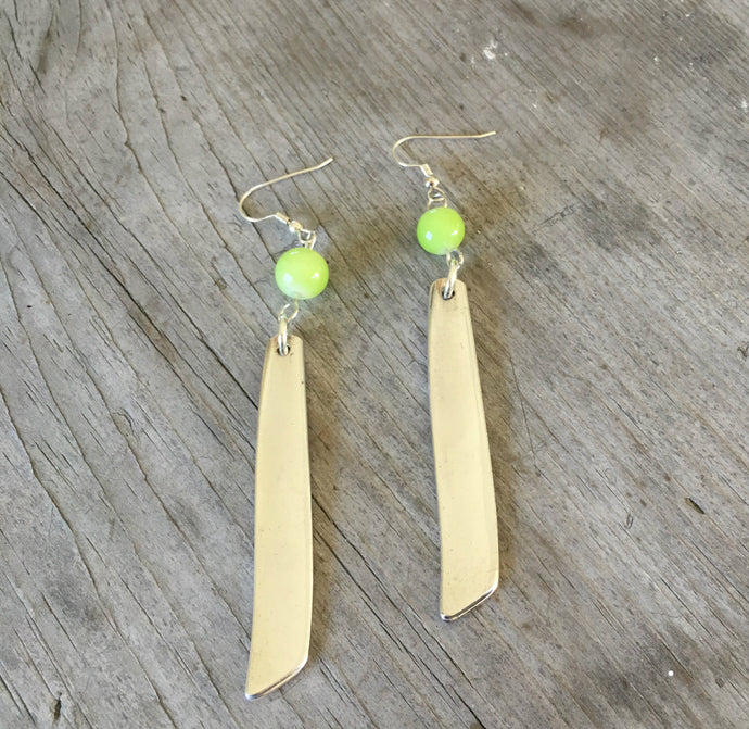 Earrings made from spoon handles in south seas pattern with chartreuse green bead