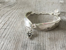 Silverware bracelet from upcycled spoon handles in the springtime pattern