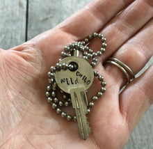 Hand Stamped Upcycled Key Necklace WILD CHILD with vintage ball chain shown in hand for scale