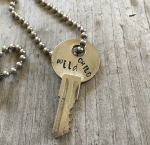 close up of Hand Stamped recycled Key Necklace WILD CHILD with vintage ball chain