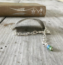 View of curve on stamped spoon bracelet about creativity