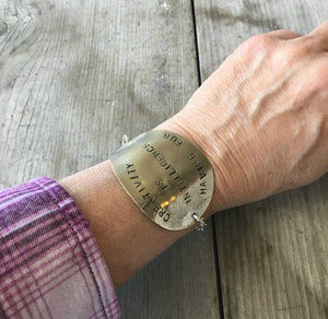 Creativity is Intelligence Having Fun Stamped Spoon Bracelet Shown on Model