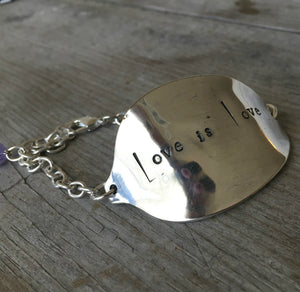 Stamped Spoon Bracelet Love is Love closeup of hand stamping of letters