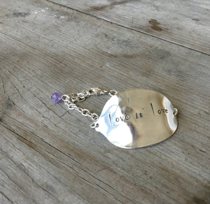 Stamped Spoon Bracelet Love is Love with lavendar glass bead