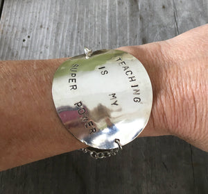 Stamped Spoon Bracelet Teaching is My Super Power Shown on Model's wrist