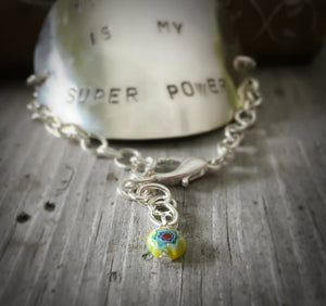 Close up of bead on teaching is my super power bracelet
