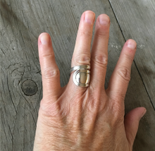 Sterling silver spoon ring in coil wrap design shown on model's hand