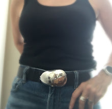 Spoon belt buckle with applied fork skull detail shown on leather belt on model