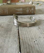 Silverware cuff bracelet made from serving spoon stamped peace