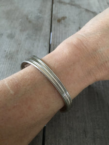 Peace Spoon Cuff bracelet shown on model's arm