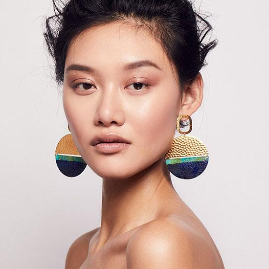 Woman wearing Issoria earrings by We Dream in Colour