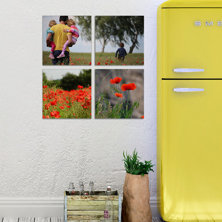 Photos printed on glass hung in a kitchen setting.