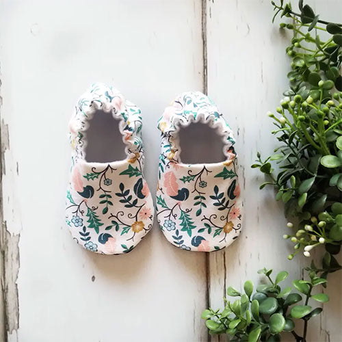 Pair of Valor Plumes Organic Baby Shoes Moccs by Weepereas