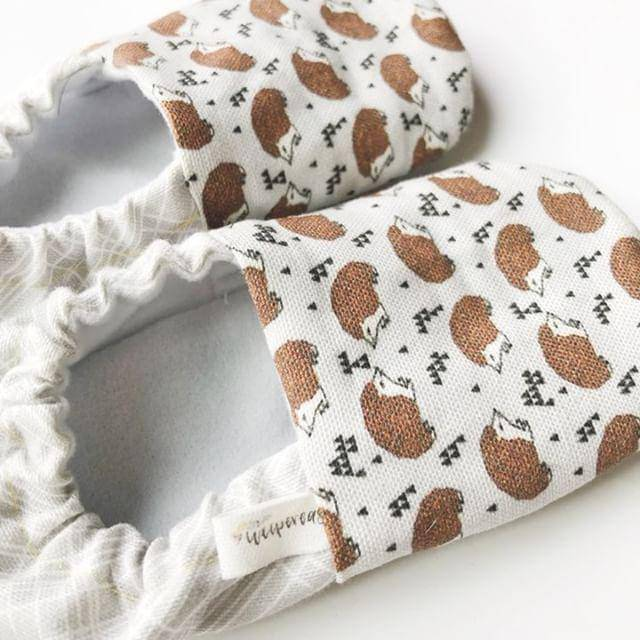 Pair of baby moccs with hedgehog pattern from Weepereas
