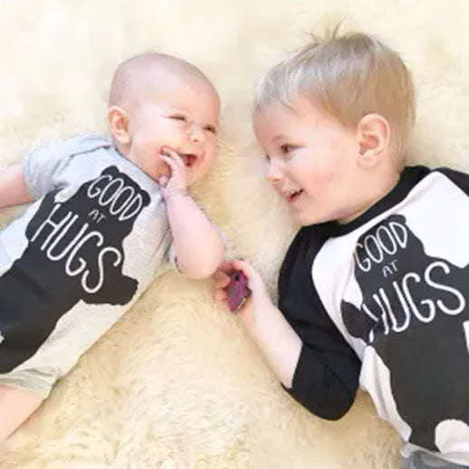 Baby and Toddler wearing Good at Hugs Cute Baby Bodysuit 6 Months by The Coin Laundry
