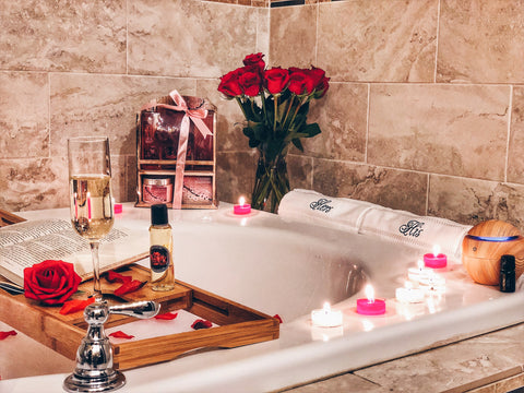 Image of his and hers hand towels romanic bath with romantic candles and rose petals