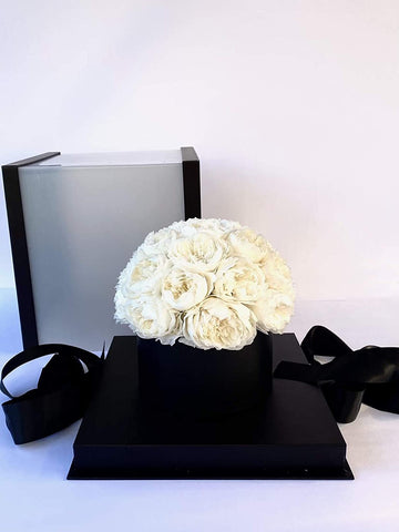 white preserved eternal roses in a box