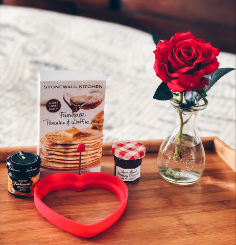 Image of pancake mix syrup strawberry jam heart-shaped mold and vase with a red rose on a breakfast tray table