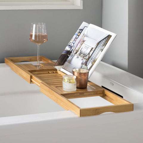 Image of extendable bamboo bath caddy