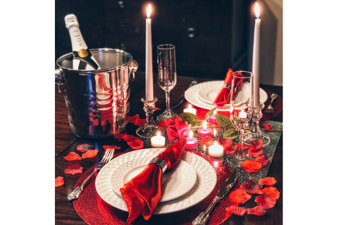 Image of romantic valentine's day dinner at home table decorations