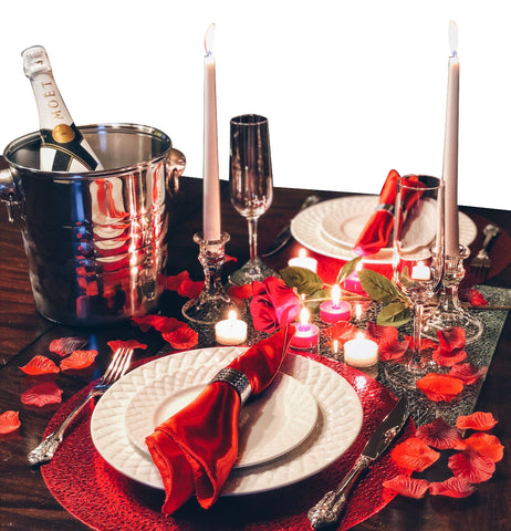 Image of stainless steel champagne bucket on a romantic dinner table setting