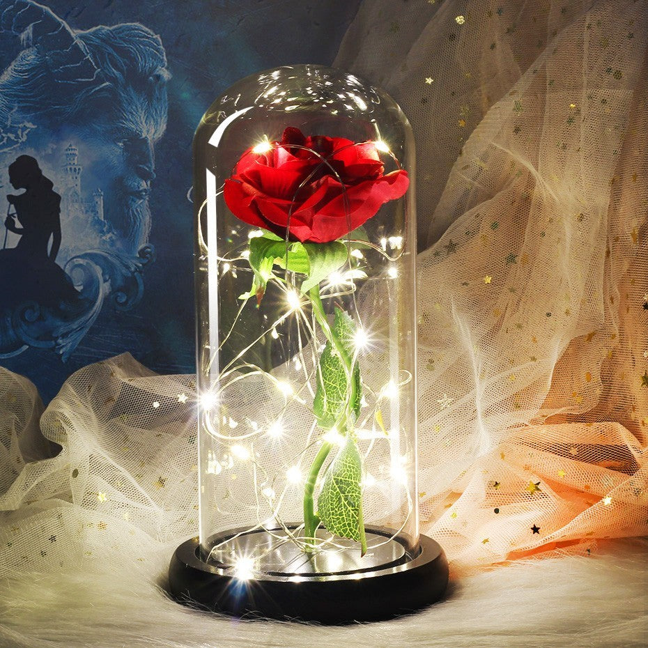 beauty and the beast rose in a glass dome
