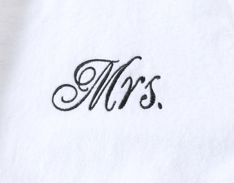 Image of Mrs stitching on couples matching Mr and Mrs bathrobes for wedding gifts
