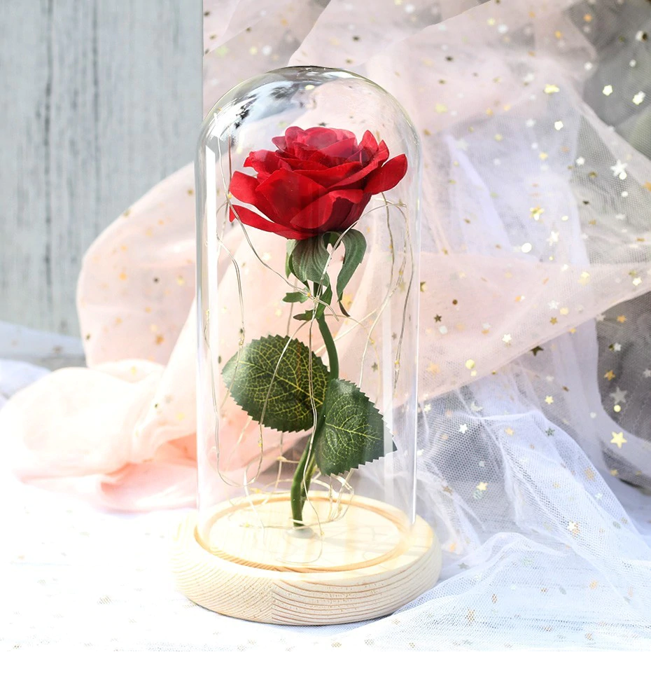 illuminated artificial rose in a glass dome