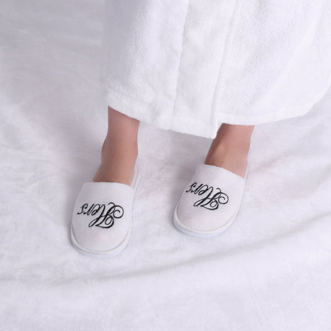 Image of his and hers robes and slippers