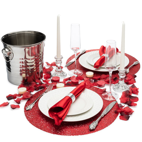 Image of romantic anniversary dinner idea with champagne bucket flutes glass candlesticks candles and rose petals