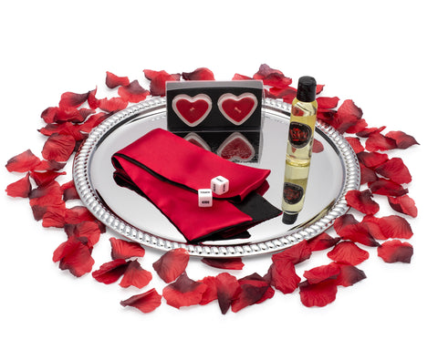 Image of massage oil blindfold adult dice romantic candles and rose petals on a serving tray for romantic night