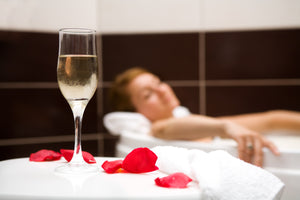 romantic bath with rose petals and candles